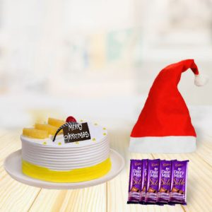 pineapple cake with christmas cap and chocolates